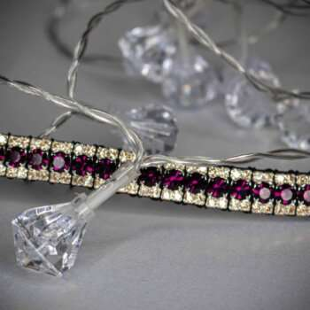 Purple Browband with amethyst and gold edging on a white background with crystal lights