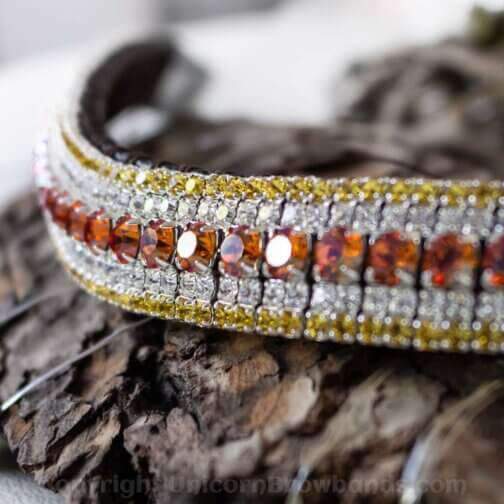 Golden lava iridescent orange and purple crystals in this luxury crystal browband by Unicorn Browbands. Edged with yummy rich, golden yellow and teamed with classy clear Preciosa crystals on a hand stitched buttery soft English sedwicks leather browband.