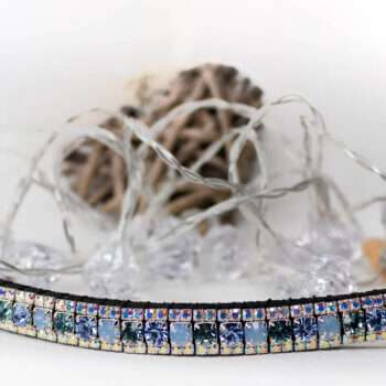 Alternating blue browband from unicorn browbands on a white back drop with crystal LED lights