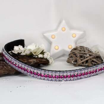 Purple and pink browband with a white star light and wooden ornaments with white flowers on a off-white backdrop