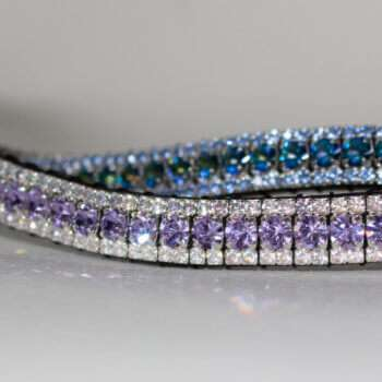 purple browbands and blue browbands crossing over on a white background for dressage and horses