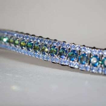 Close up of a Colour changing Bermuda Blue and Light Sapphire Browband on a white background