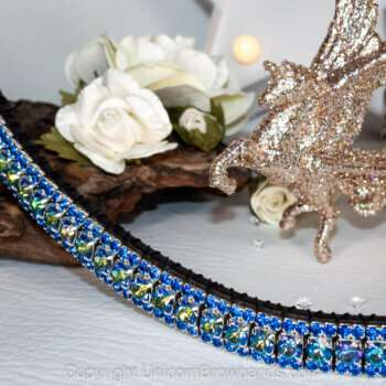 A bright blue browband on a white background featuring tree bark and white flowers